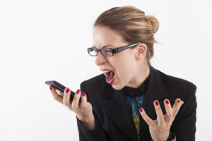 Businesswoman screaming at cell phone